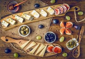 platter of italian cheeses with figs,
