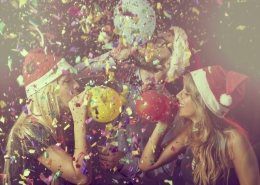 New Year's Eve party on midnight blowing colorful